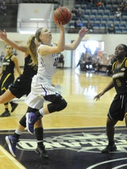 ACU's Breanna Wright drives to the basket against a