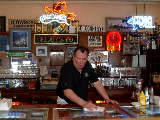 In this photo from 2003, Dan Dodge works the bar at