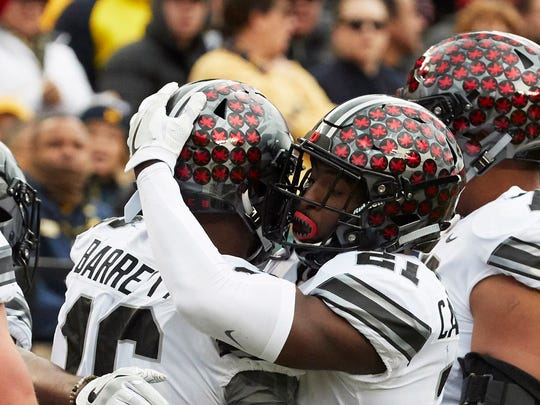 Ohio State H-back Parris Campbell congratulates quarterback J.T. Barrett on his 21-yard touchdown run.