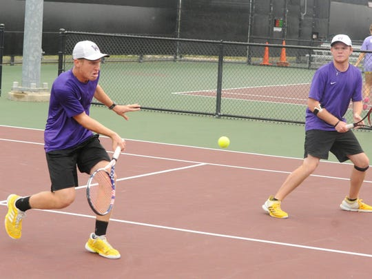 Wylie's Zane McCurley, left, hits a shot as his No. 2 boys doubles partner Cole Edwards looks on against Fredericksburg in the Class 4A state finals on Thursday, Nov. 2, 2017 at the George P. Mitchell Tennis Center in College Station. McCurley and Edwards won 6-4, 6-1.