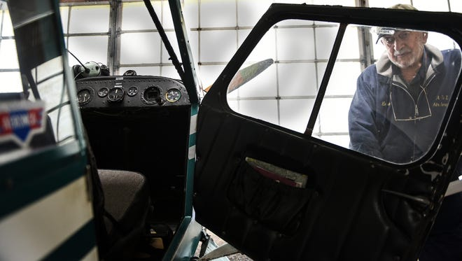 Ernie Artz looks at a Aeronca 7AC that was used to teach pilots to fly at Farmers Pride Airport in Fredericksburg on Wednesday, March 30, 2016.