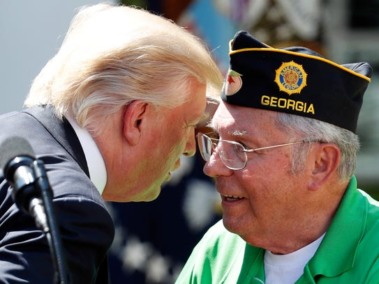 President Trump reacts with Bob Turner, director of