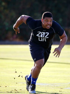 Offensive guard Denzelle Good, from Mars Hill University, runs up the field during the NFL Super Regional Combine football workout drills Saturday, March 21, 2015, in Tempe, Ariz. (AP Photo/Ross D. Franklin)