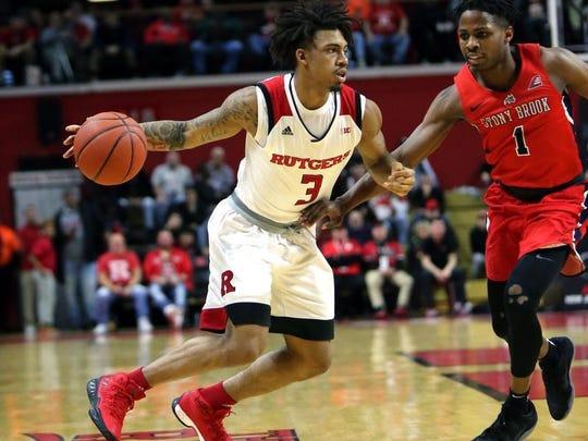 Rutgers guard Corey Sanders dribbles against Stony Brook.