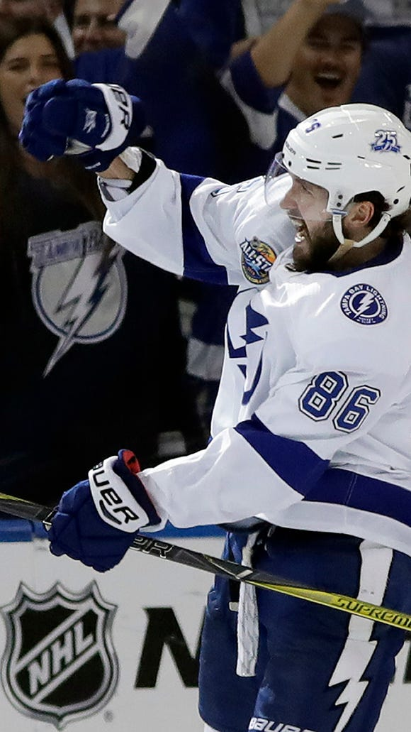 Tampa Bay Lightning right wing Nikita Kucherov (86), of Russia, celebrates his goal against the St. Louis Blues during the third period of an NHL hockey game Saturday, Oct. 14, 2017, in Tampa, Fla. (AP Photo/Chris O'Meara)