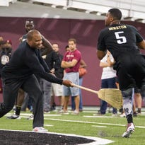 Trainier George Whitfield, left, tries to disrupt quarterback Jameis Winston during Florida State Pro Day in Tallahassee, Fla., Tuesday, March 31, 2015. (AP Photo/Mark Wallheiser)