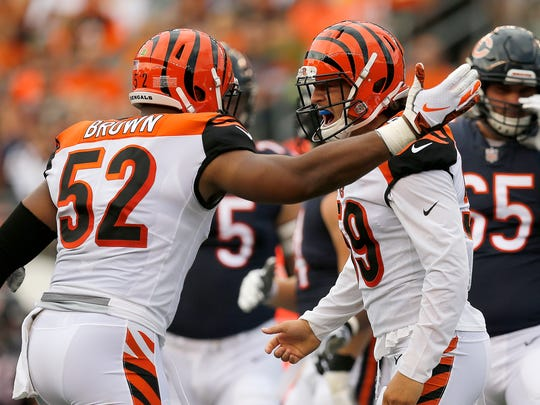 Cincinnati Bengals linebacker Nick Vigil (59) and linebacker Preston Brown (52) celebrate a stop on the kid off in the first quarter of the NFL Preseason Game One between the Cincinnati Bengals and the Chicago Bears at Paul Brown Stadium in downtown Cincinnati on Thursday, Aug. 9, 2018.