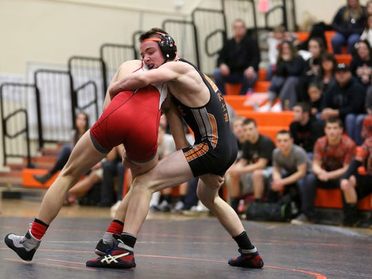 Sprague High School's Michael Murphy, right, wins his match against McMinnville's Steven Weant.