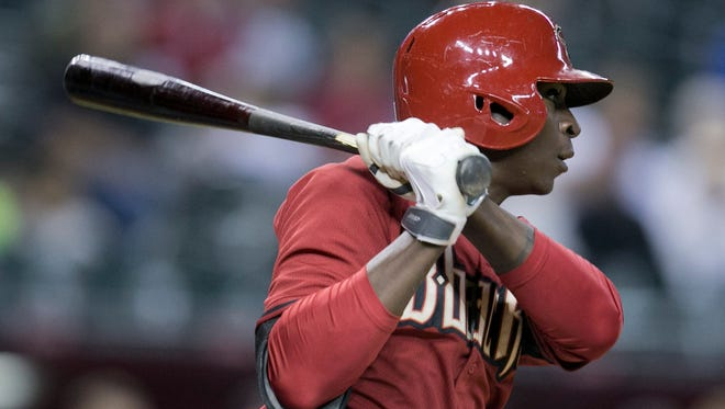 The Diamondbacks' Didi Gregorius hits a ground ball against the Cubs at Chase Field in Phoenix on Friday, March 28, 2014.