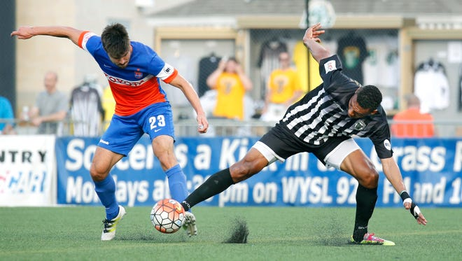 Steevan Dos Santos (right) shown in a match in July, has scored in two straight matches for the Rhinos, who open the playoffs at home next Saturday against Charlotte.