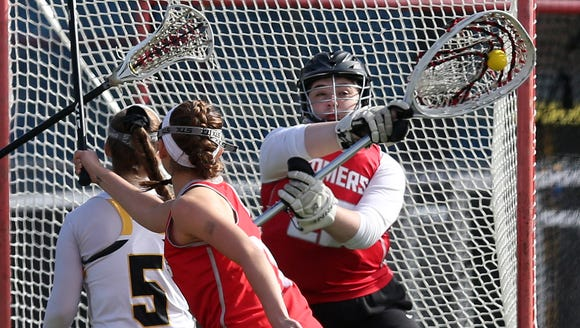 Somers goalie Victoria Coviello (29) stops a shot from