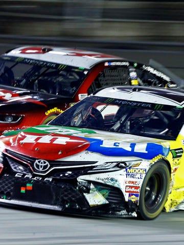 Kyle Busch (18) gets past Austin Dillon during the NASCAR Cup Series auto race, Saturday, Aug. 18, 2018, in Bristol, Tenn. (AP Photo/Wade Payne)