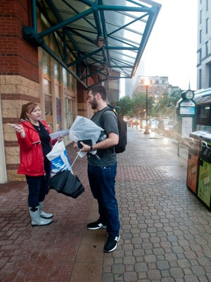 Diane Nilest, a production sales manager for TARC, informs Justin Block, a Humana employee, where to catch a bus once the construction project at the Kentucky International Convention Center begins. The stop will be closed for the duration of the project as will Fourth Street between West Jefferson and Market Streets. August 17, 2016