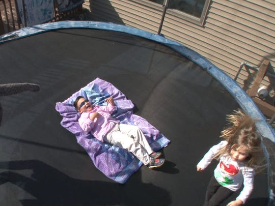 Gavin Kane, 6, who has severe brain trauma from a car accident five years ago, bounces on a trampolene with his cousin and sister at their Toms River home Wednesday, March 5, 2017.   Gavin's dad Christian is starting a huge fund raising movement to build what he calls a Field of Dreams in Toms River, where kids with disabilities can go to play.