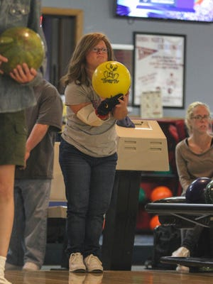 "Rachel Weiner, uses her Tweety Bird bowling ball during the DAWN Center for Independent Living's annual ""Lucky Strike Night"" Bowling Event."
