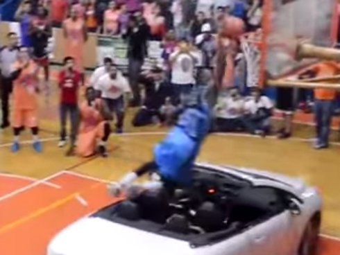 Player tries to dunk over car fails spectacularly