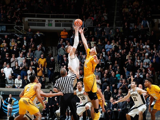 Dec. 7: Purdue Boilermakers center Isaac Haas (44) squares off for the opening jump ball against Valparaiso Crusaders center Jaume Sorolla (14) during the first half at Mackey Arena.