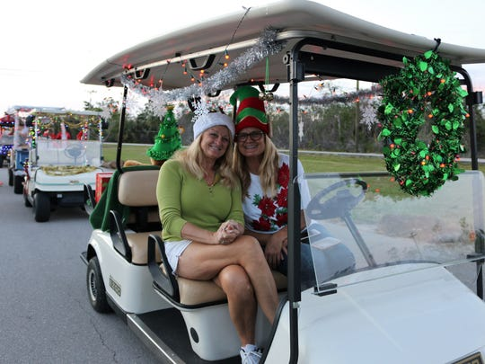 Sisters Debbie Bratz and Susan Marrero have fun at the parade lineup. On Christmas Eve, Dec. 24, 2017, Capri residents gathered for the 10th Annual Golf Cart Parade.