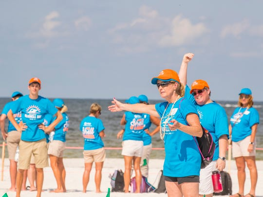 Volunteers directed the participants where to go. At The Outrigger Beach Resort tiki hut on Fort Myers Beach, just over 1,000 volunteers gathered on National Seashell Day to form a human seashell.