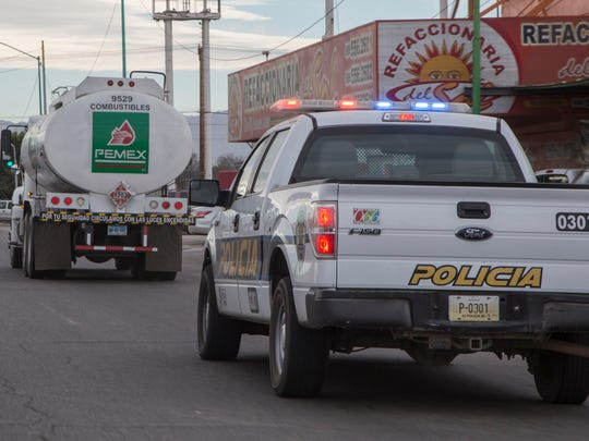 A police vehicle escorts a gasoline delivery truck in Mexicali, Mexico on Thursday, January 12, 2017. Protest over gasoline prices had caused a gasoline shortage in parts of Mexico.