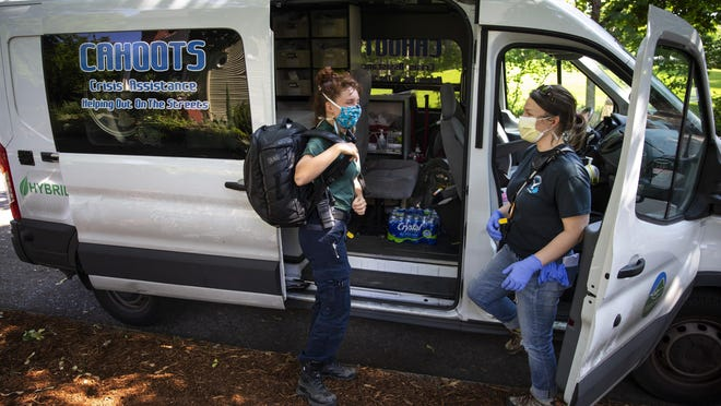 CAHOOTS emergency medical technician Summer Johnson, left, and crisis worker Amy May stop by Monroe Park in Eugene at the end of their 12-hour shift. The Eugene-based mobile crisis intervention program of White Bird Clinic has become a nationwide model as cities search for ways to handle calls for service without involving the police. [Chris Pietsch/The Register-Guard] - register-guard.com