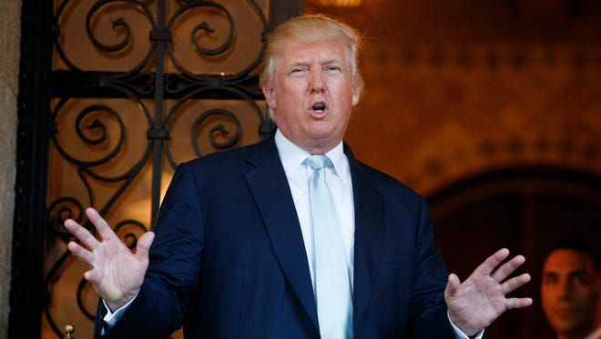 In this Dec. 28, 2016 file photo, President-elect Donald Trump speaks to reporters at Mar-a-Lago in Palm Beach, Fla.