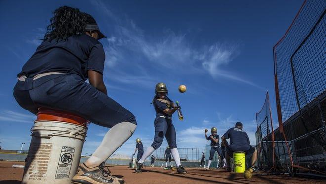 Desert Vista's Kiki Kennedy tosses balls to teammates during a practice on February 16, 2017 at Desert Vista High School in Phoenix, Ariz.