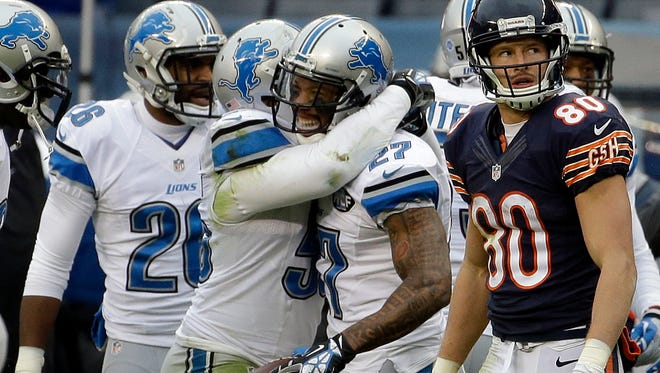 Detroit Lions safety Glover Quin (27) celebrates with teammates after intercepting a pass against the Chicago Bears on Jan. 3, 2016, in Chicago.