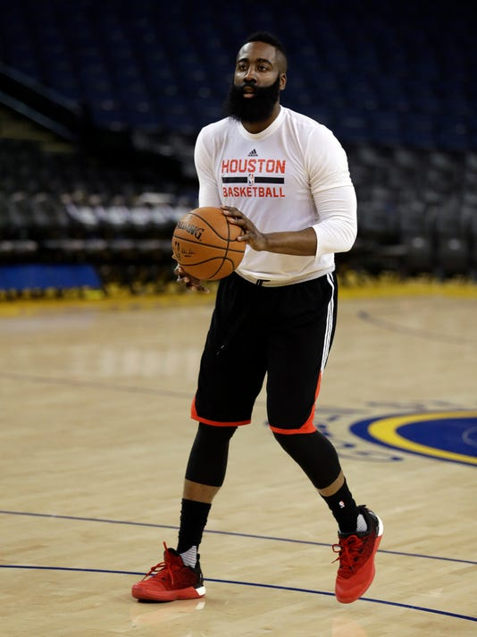 Houston Rockets' James Harden prepares to shoot during practice Friday, April 15, 2016, in Oakland, Calif. The Rockets play the Golden State Warriors in Game 1 of an NBA basketball first-round playoff series Saturday. (AP Photo/Ben Margot)