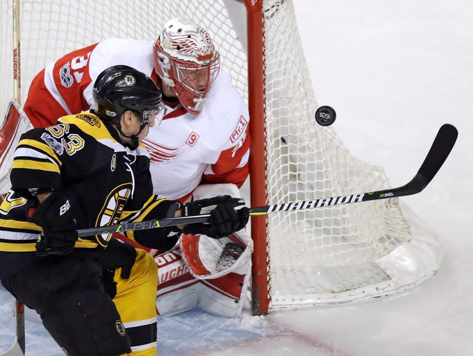 Boston Bruins left wing Brad Marchand (63) tries to