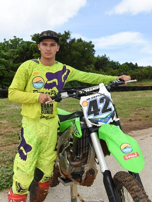 Motocross racer JR Cepeda with his dirt bike during the Monster Energy 2016 Guam Motocross Championship Series at the Guam International Raceway in Yigo on Aug. 7.