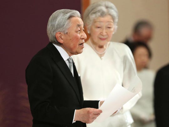 Japan's Emperor Akihito, accompanied by Empress Michiko, speaks during the ceremony of his abdication in front of other members of the royal families and top government officials at the Imperial Palace in Tokyo, Tuesday, April 30, 2019.
