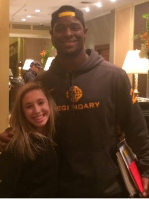 Waukesha West student Ava Tarantino is photographed with Pittsburgh Steelers running back Le'Veon Bell.
