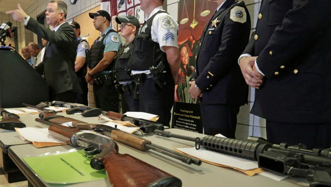 Chicago Police Superintendent Garry McCarthy speaks at a news conference  as police displayed Chicago police display some of the thousands of illegal firearms they have confiscated in 2014 their battle against gun violence.