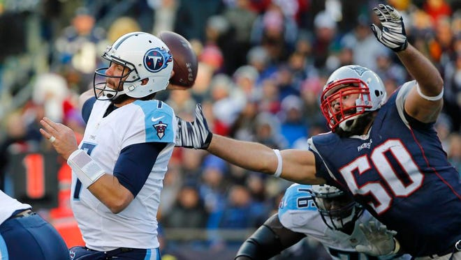 Patriots defensive end Rob Ninkovich tries to get to the ball before Titans quarterback Zach Mettenberger throws a pass during the second half.
