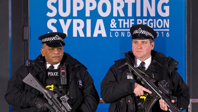 British armed police officers stand guard outside the QEII center in central London on Feb. 4, 2016, ahead of the start of a donor conference for Syria.