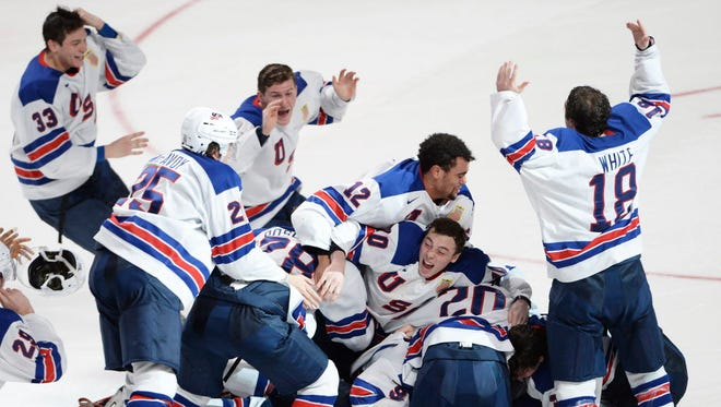 Team USA celebrates its victory over Canada in the final of the World Juniors.