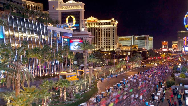 In this Dec. 4, 2011 file photo, runners stream southward on Las Vegas Boulevard during the Rock 'n Roll Las Vegas Marathon in Las Vegas.