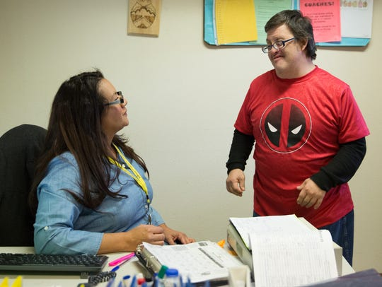 Steve Barela, right, talks with Lorena Gonzales, a