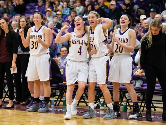 Sophomore guard Renee Stimpert (4), a Crestview grad, celebrates with her Ashland University teammates earlier this season. The Eagles advanced to the Elite Eight  with their 71st straight win Monday night.