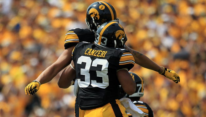 Iowa's Jordan Canzeri celebrates his touchdown with Jacob Hillyer during their game against Illinois State with at Kinnick Stadium on Saturday, Sept. 5, 2015.