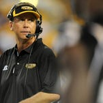 Jason Munz/Hattiesburg AmericanSouthern Miss head coach Todd Monken directs his players Tuesday during the Golden Eagles' first fall practice of the 2015 season.