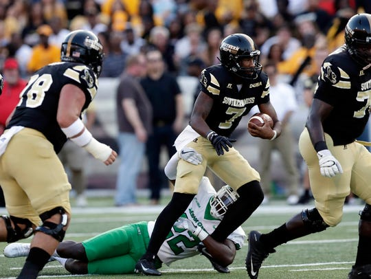 Southern Miss quarterback Kwadra Griggs (7) is tackled