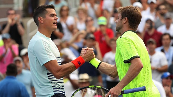 Ryan Harrison of the United States (right) shakes hands with Milos Raonic of Canada (left) after their match on day three of the 2016 U.S. Open tennis tournament at USTA Billie Jean King National Tennis Center on Aug. 31.