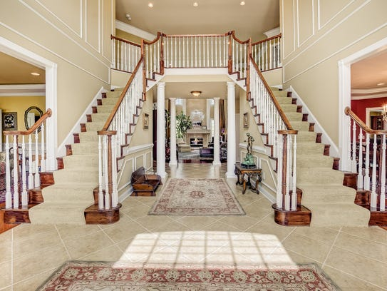 Am  amazing double staircase is featured in the foyer.