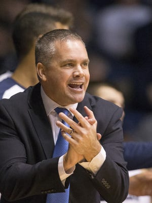 Chris Holtmann claps for a strong defensive effort as his Butler team beat Virginia Military Institute 93-66, at Hinkle Fieldhouse, Indianapolis, Monday, Dec. 7, 2015.