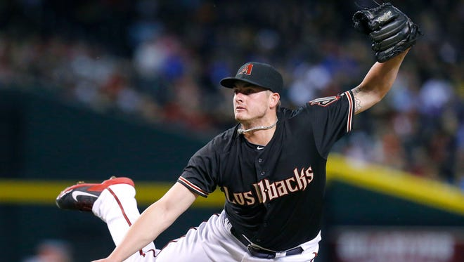 Arizona Diamondbacks relief pitcher Addison Reed throws in their 5-2 win over the St. Louis Cardinals on Sept. 27,  2014, in Phoenix