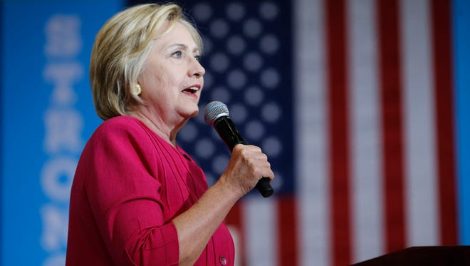 Hillary Clinton speaks at West Philadelphia High School on Aug. 16. She is trying to reach across the aisle and appeal to Republicans who are disenchanted with the GOP nominee, Donald Trump.