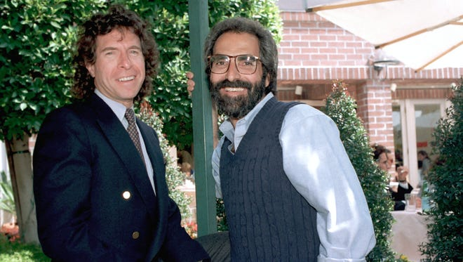 This March 25, 1989, file photo shows Paul Junger Witt, left, and Tony Thomas posing in Los Angeles, Calif.