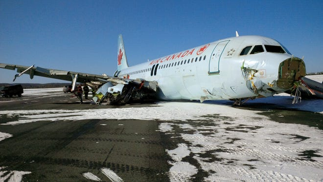 This March 29, 2015, handout photo provided by the Canada Transportation Safety Board shows damage to an Air Canada Airbus A-320 that skidded off the runway at Halifax International Airport in Nova Scotia.